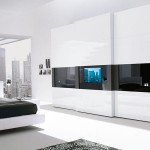 Modern-Bedroom-Wardrobe-with-TV-Built-In-Door-By-Presotto